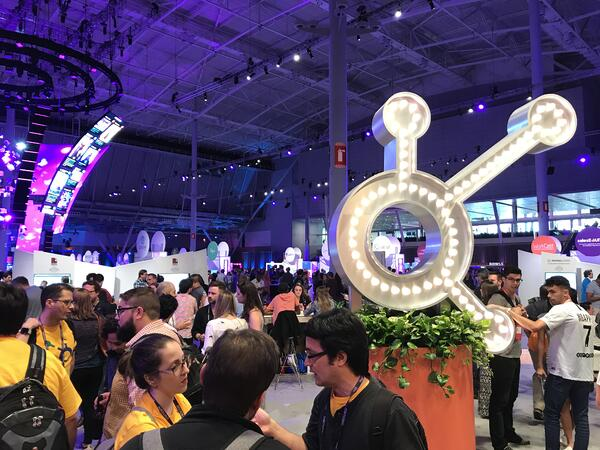 hubspot logo light and people in club inbound hubspot zone at inbound 18