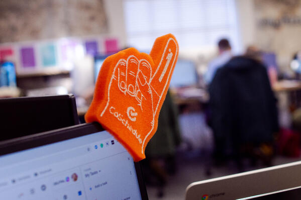 coschedule foam finger with core values in background