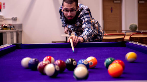 Bilal playing pool