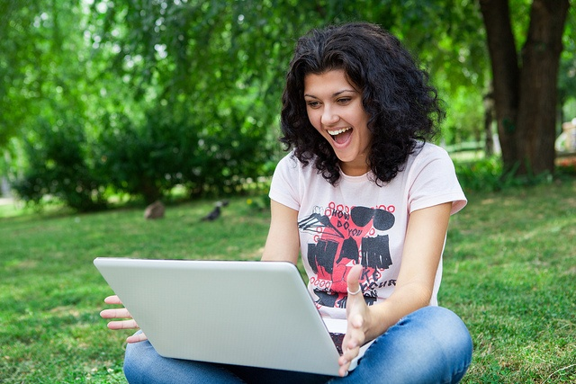 Woman happy using laptop
