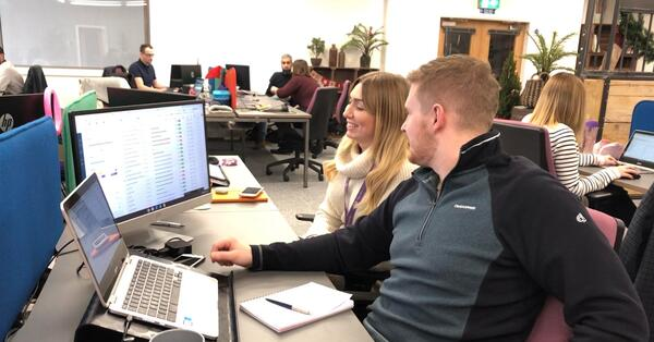 amy and dan working in digital 22 office