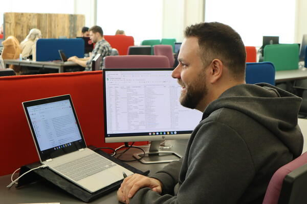rikki working in digital 22 office