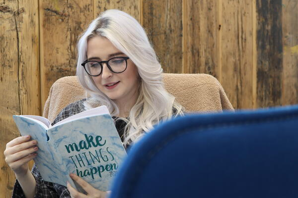 molly reading book in digital 22 office