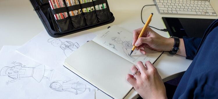 drawing in a notebook