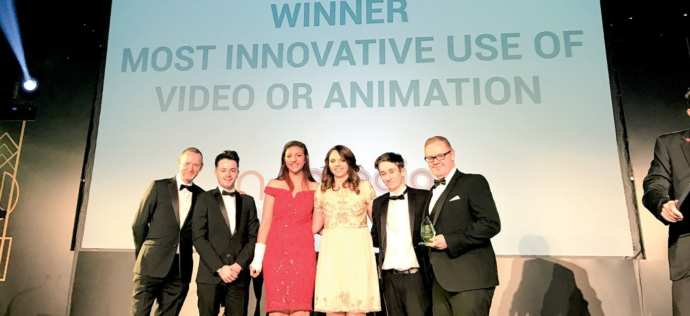 Photo of the team getting the award