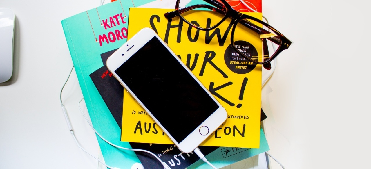 iphone and pile of books