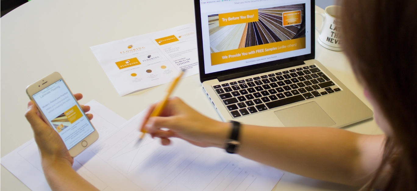 design work on mobile and laptop