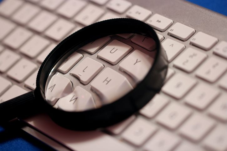 magnifying glass on a keyboard
