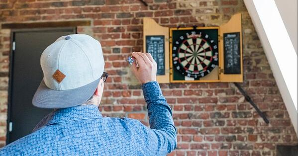 target man playing darts